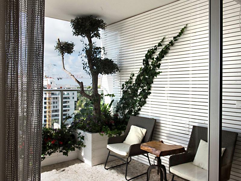 גינת גג של ציפי ושמוליק – אדניות עץ ותחושה לבבית